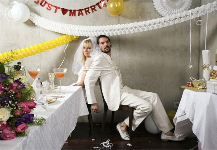 Newlywed Couple Tied up at Wedding Reception